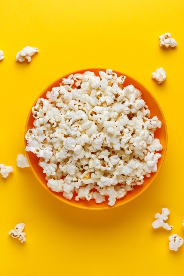 Free Popcorn In An Orange Bowl. Stock Photo - 115136900