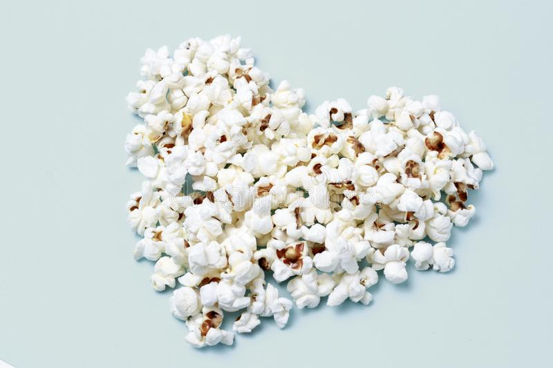 Popcorn laid out in the shape of a heart close-up, top view royalty free stock image
