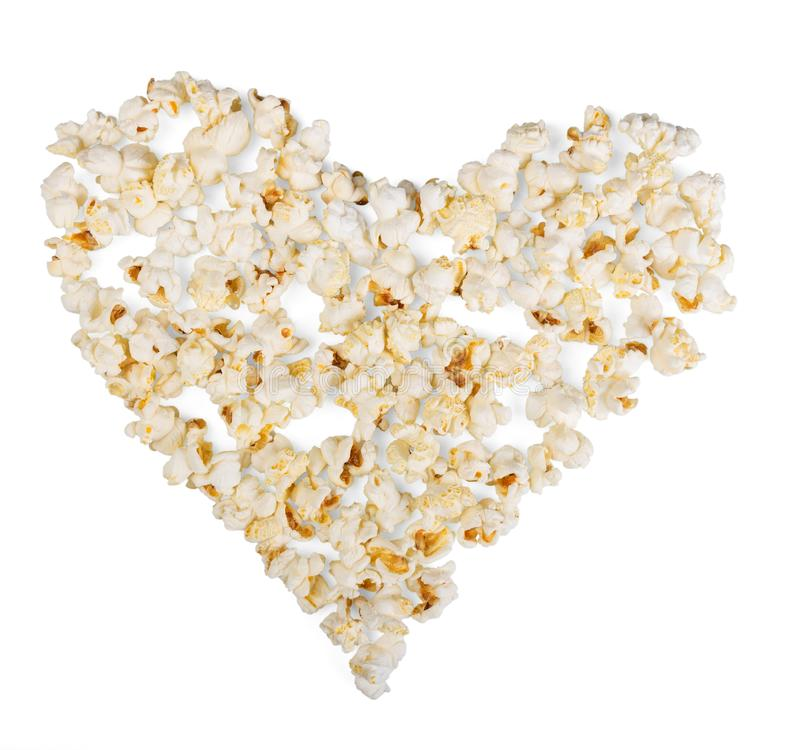Popcorn, laid out in shape of heart on white background. stock photography
