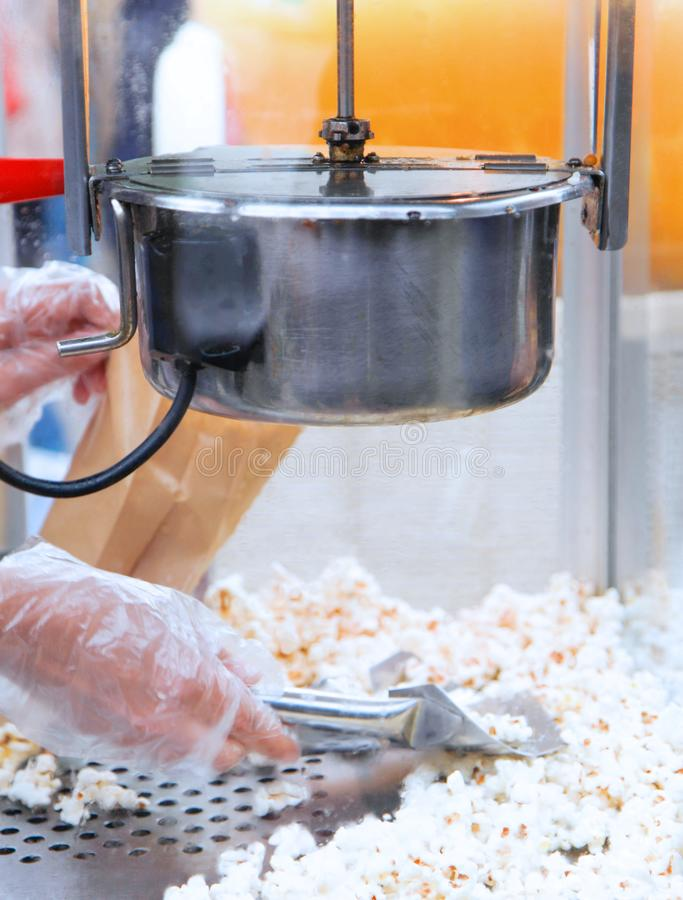 Popcorn machine being operated by a woman stock photo