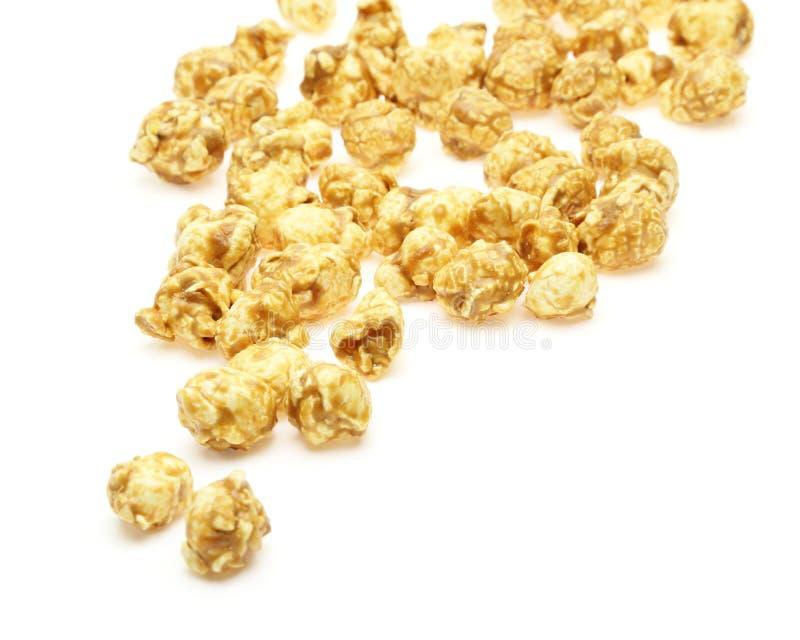 Popcorn met karamelstroop die wordt gecombineerd royalty-vrije stock foto's