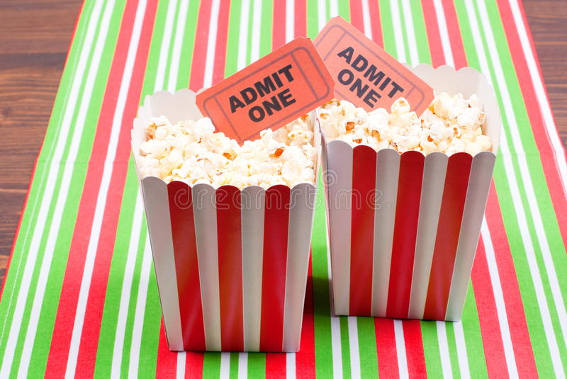 Popcorn on movie tickets desk top view royalty free stock photo