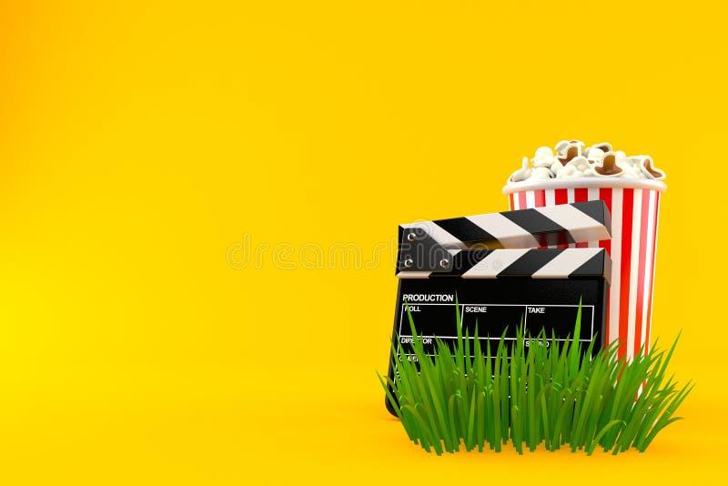 Popcorn och panelbräda på gräs royaltyfri illustrationer