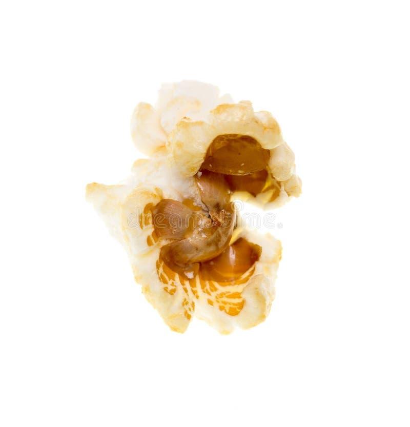 Popcorn på en vit bakgrund royaltyfri fotografi