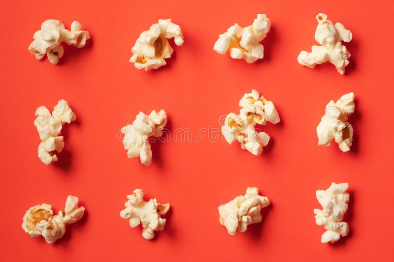 Popcorn pattern on red background royalty free stock photos