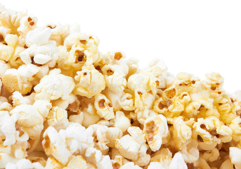 Popcorn. Pile of popcorn on a white background royalty free stock photo