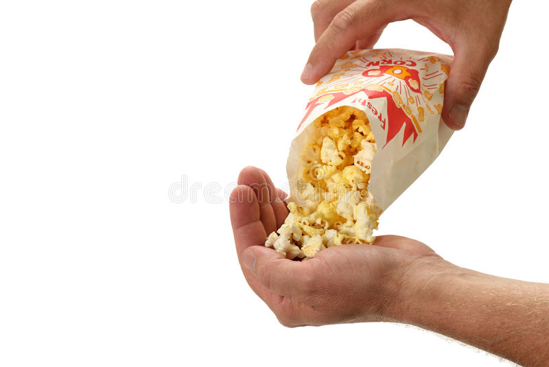 Popcorn Poured Into A Hand Stock Photography