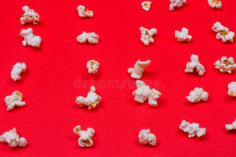 Popcorn on red background royalty free stock photos