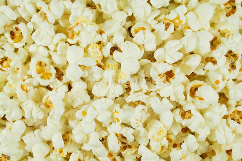Popcorn salted white ready. On all photos. Wallpaper. Popcorn salted white ready. On all photos stock photography