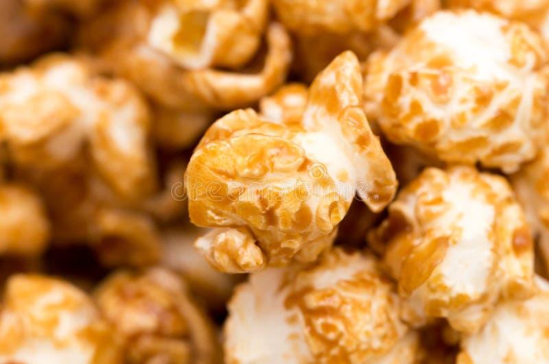 Popcorn som en bakgrund Makro arkivbild