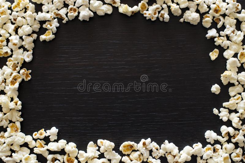 Popcorn texture top view with space for text. pattern of popcorn close up, blck background stock photography