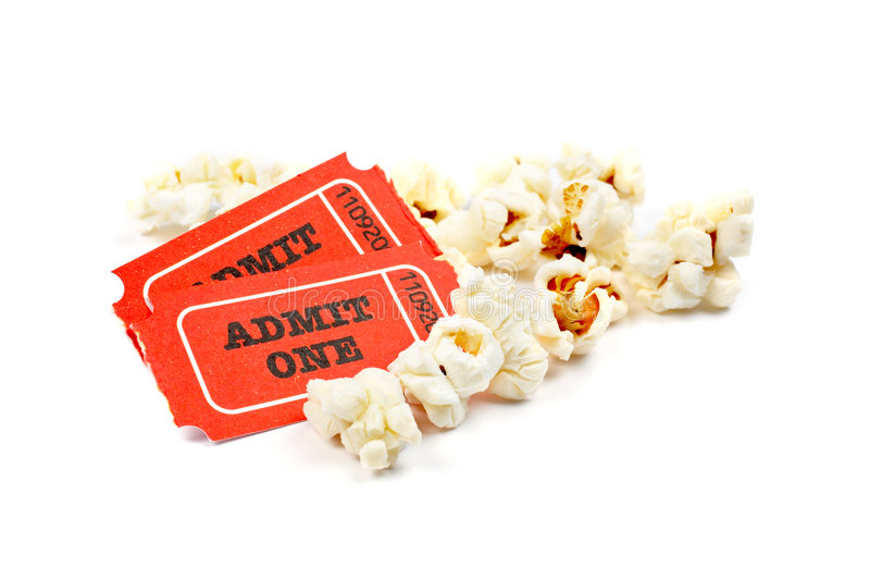 Popcorn and two tickets royalty free stock image