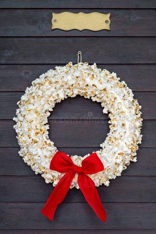 Popcornkranz mit Namensschild lizenzfreie stockbilder
