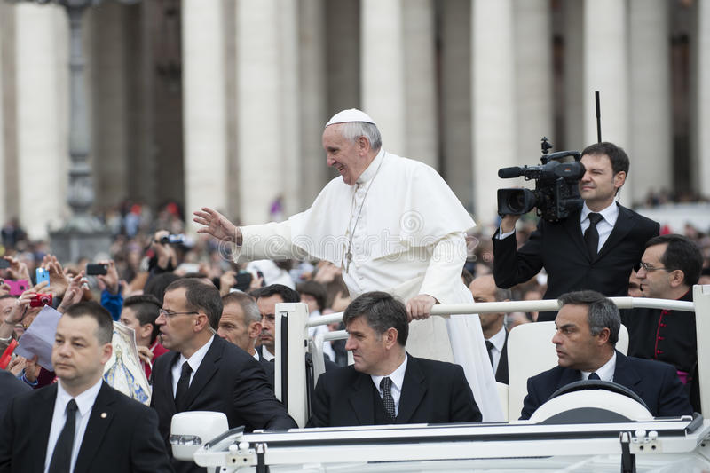 Pope Francis bless faithful. Vatican City, Rome, Italy - November 13, 2013: Pope Francis on the popemobile blesses the faithful in St. Peter's Square