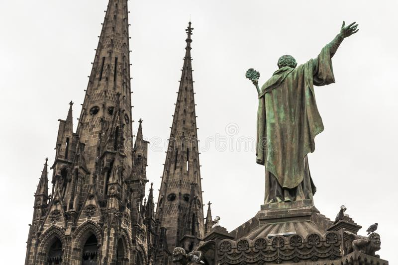 Pope Urban II, Clermont-Ferrand, France. Clermont-Ferrand, France. Statue of Pope Urban II 1035-1099 overlooking the towers of the Gothic Cathedral of Our Lady royalty free stock photos