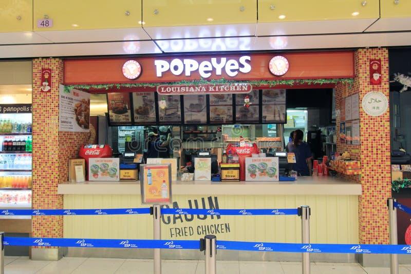 Popeyes restaurang i den Hong Kong International flygplatsen arkivfoton