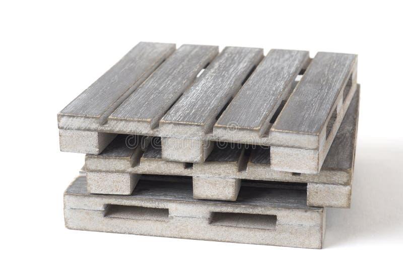 Popielaci drewniani puści barłogi odizolowywający na białym tle obrazy stock