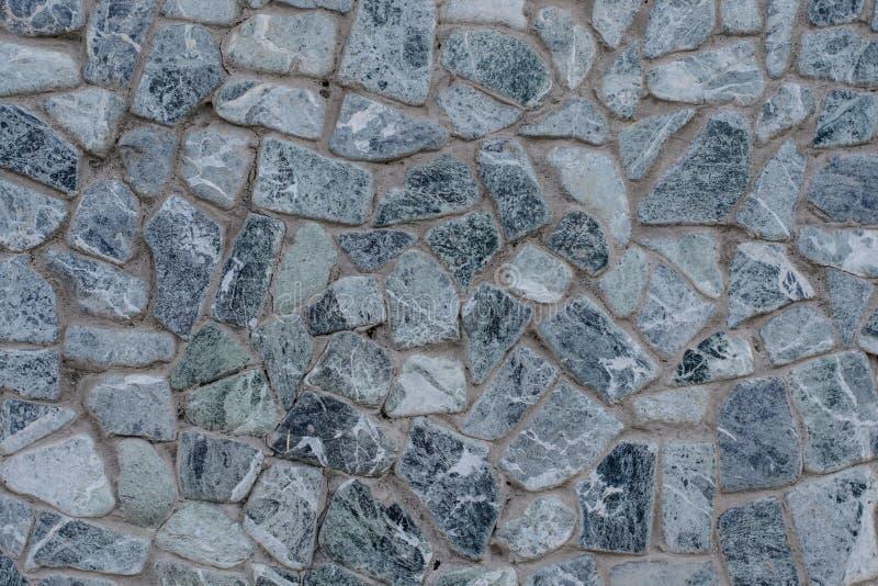 Popielate szarość wyszczególniający kamienia zakończenie w górę pięknego z betonowa ściana kamienia teksturą nowożytny dom Biały  obraz stock