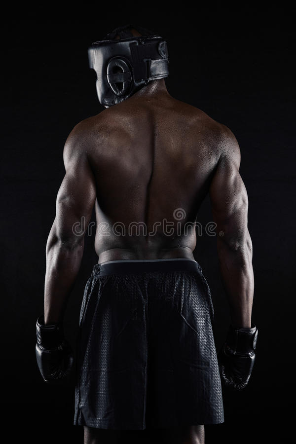 Popiera silny młody męski bokser obraz stock