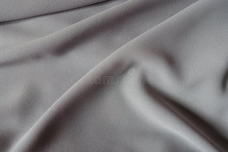 Popolare molli sul tessuto grigio del georgette di crêpe immagine stock libera da diritti