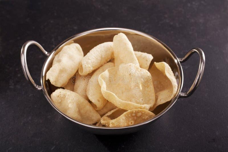 Poppadums in an Indian Balti Dish stock image