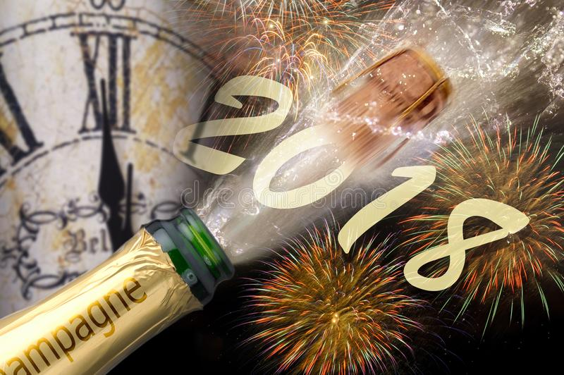 Popping champagne and fireworks at silvester 2018. Popping champagne and fireworks at silvester and new years eve 2018 with clock at midnight royalty free stock photo