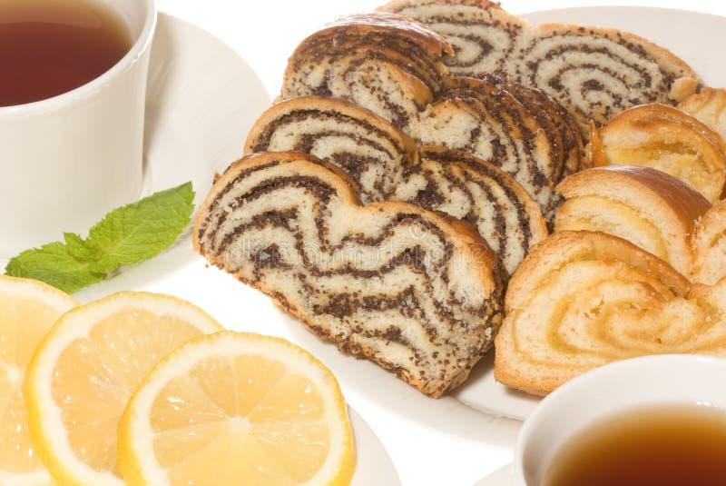 Poppy Amd Lemon Cake With Tea Stock Images