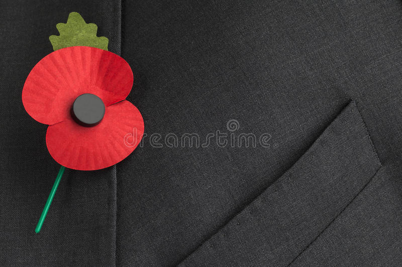 Poppy Appeal for Remembrance / Poppy Day. Poppy on jacket lapel for Remembrance Day, with text / copy space stock photo