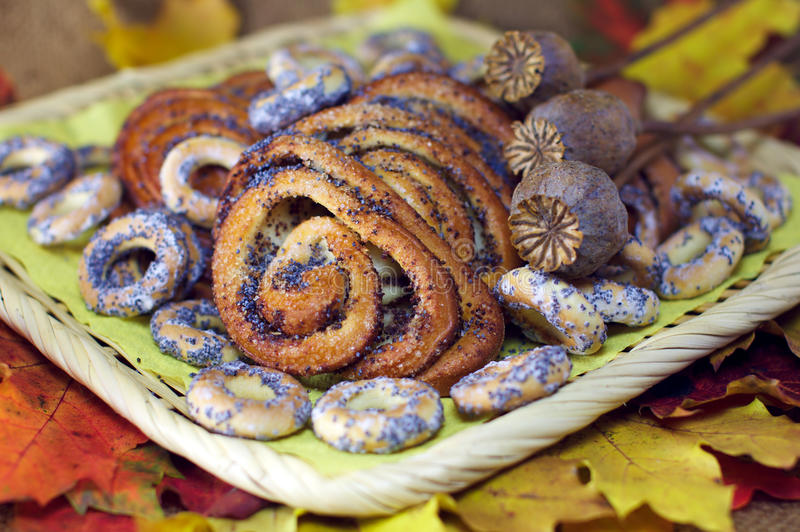Poppy buns and bagels autumn leaves background royalty free stock image