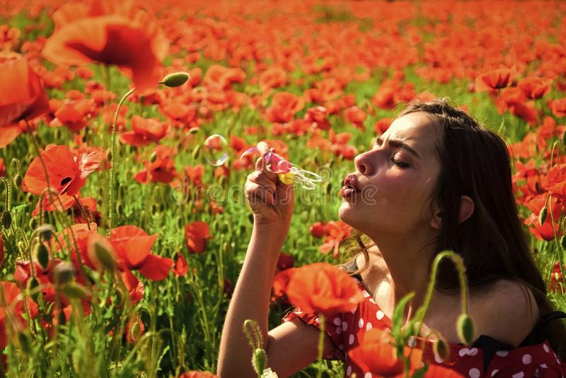 Poppy, Remembrance day, Anzac Day. Summer, spring, poppy flower. Opium poppy, youth, freshness, ecology, woman. Drug opium narcotics carelessness Woman blow royalty free stock photo