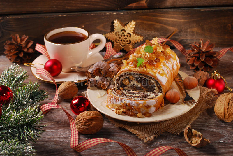 Poppy seed cake and coffee for christmas on wooden table royalty free stock photos