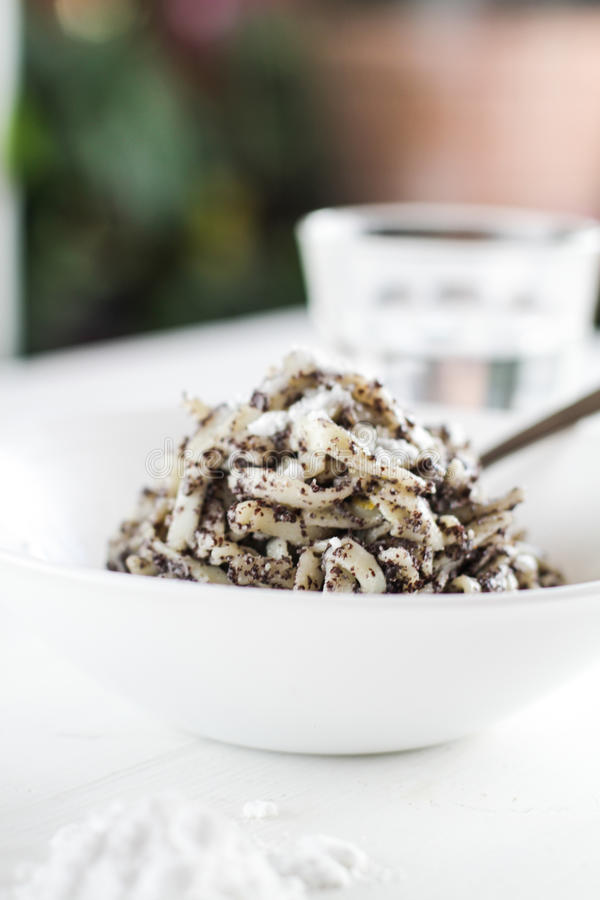 Poppy seed pasta with powder sugar royalty free stock photo
