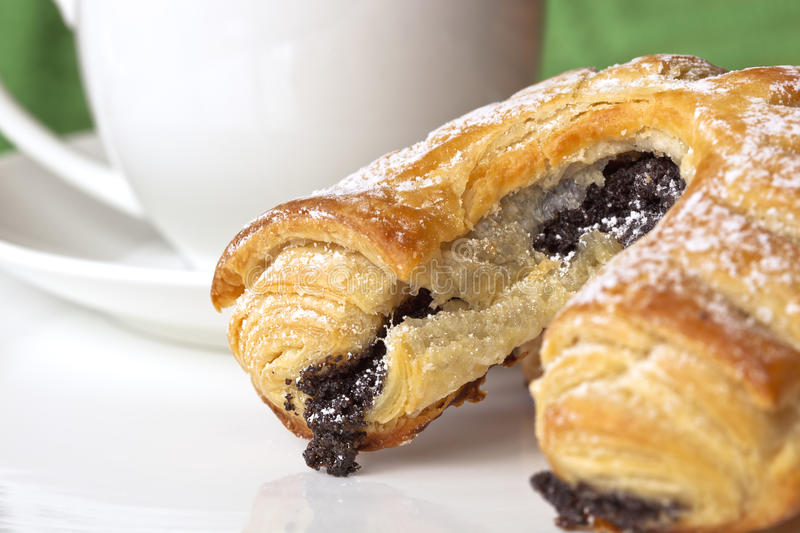 Poppy Seed Pastry and Coffee. Continental poppy seed pastry with a cup of coffee stock photos