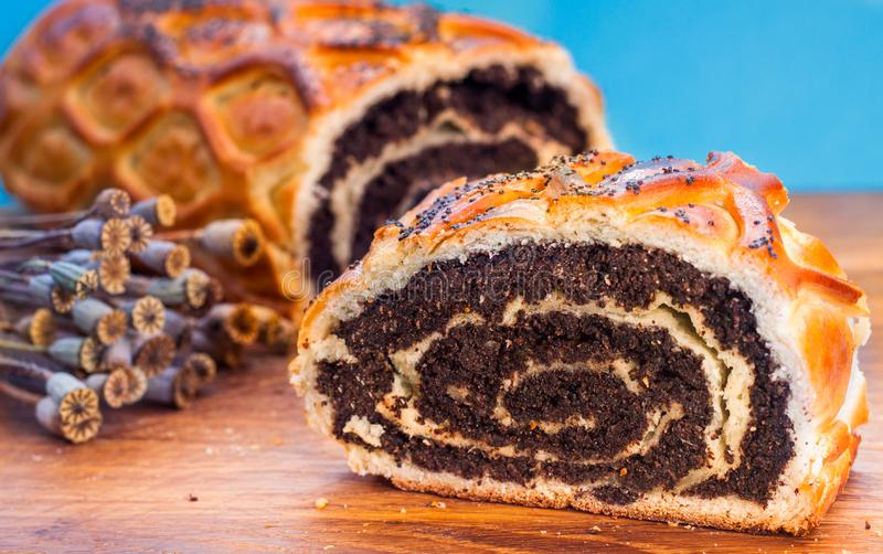 Poppy seed Roll on a wooden desk, closeup stock photos