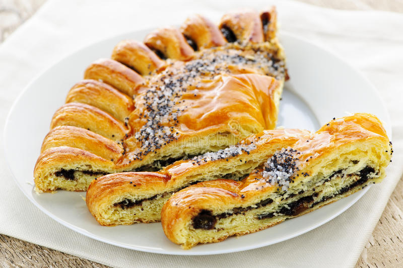 Poppy seed strudel. Closeup of poppy seed strudel dessert pastry with slices royalty free stock photo