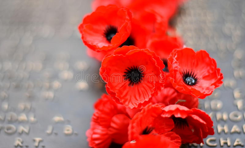 Poppy wall lists the names of all the Australians who died in service of armies stock photos