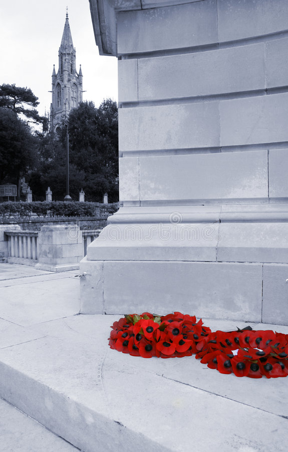 Poppy wreaths on war memorial stock photo