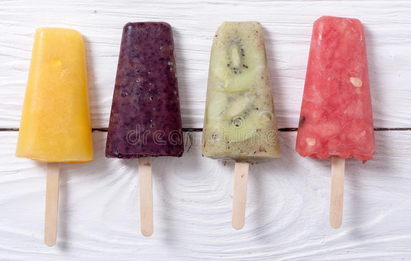 Popsicle with fruits. Popsicle with kiwi , orange , blueberry and watermelon royalty free stock photos