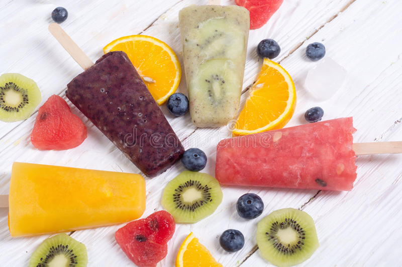 Popsicle with fruits. Popsicle with kiwi , orange , blueberry and watermelon royalty free stock images