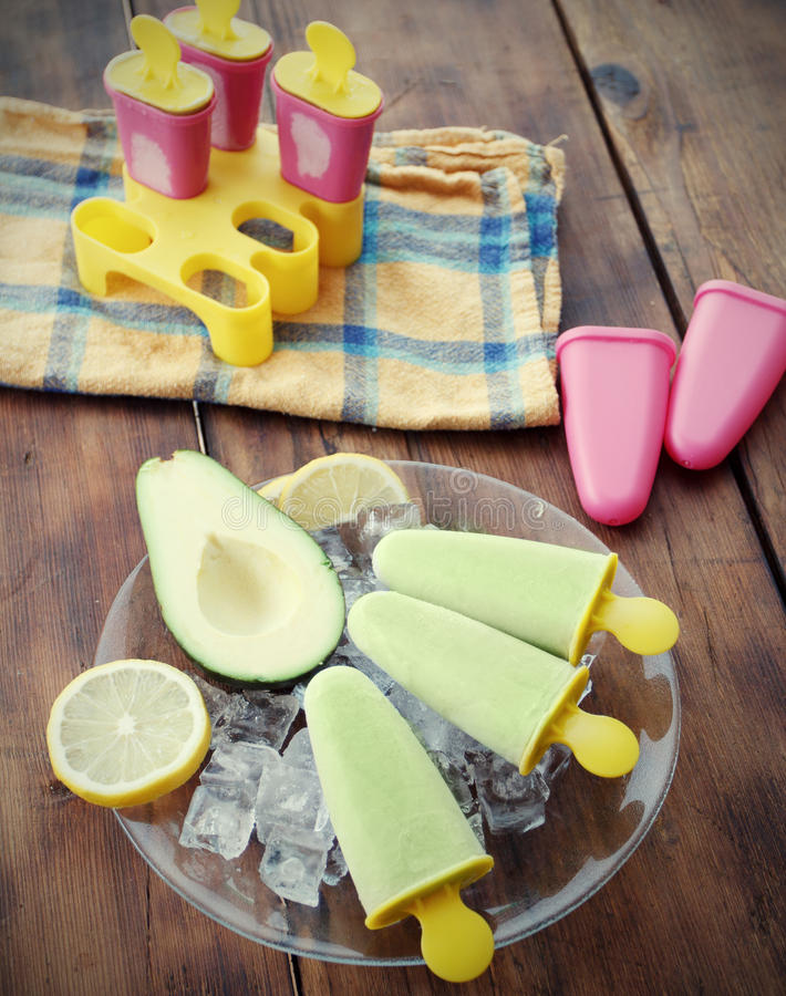 Popsicle. Homemade Avocado Popsicle, with ice cubes stock photography