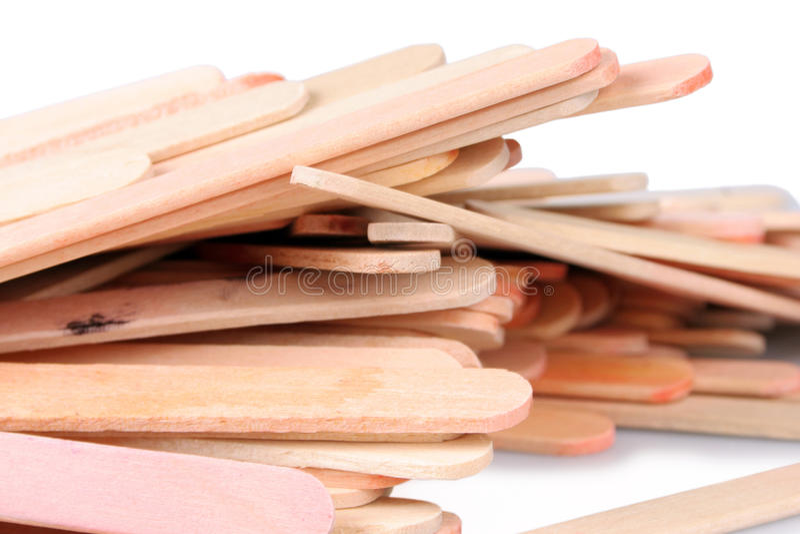 Popsicle Sticks. Shot of several popsicle sticks over white royalty free stock image