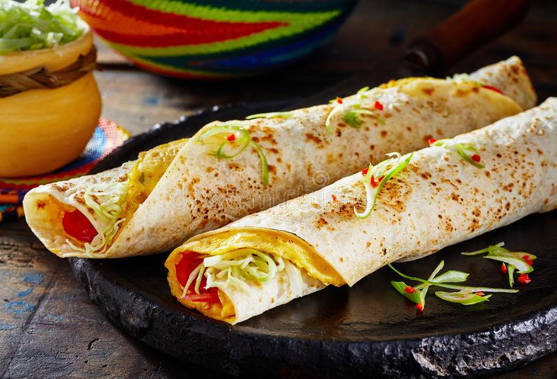 Popular African street food with Rolex Rolls stock image