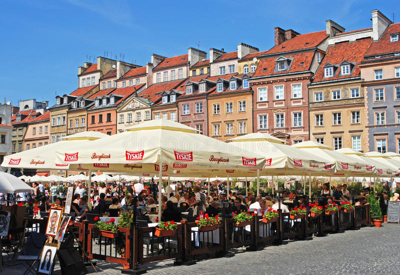 Popular Al Fresco Dining during Summer Time at Warsaw Old Town Market Place. Popular Al Fresco Dining with big umbrella sponsored by Tyskie Brewery during Summer royalty free stock images