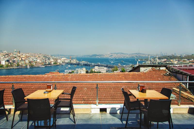 Popular cafe with a view of Galata bridge, Golden horn. Popular cafe n Istanbul with a view of Galata bridge, Golden horn and Bosphorus on background royalty free stock photos