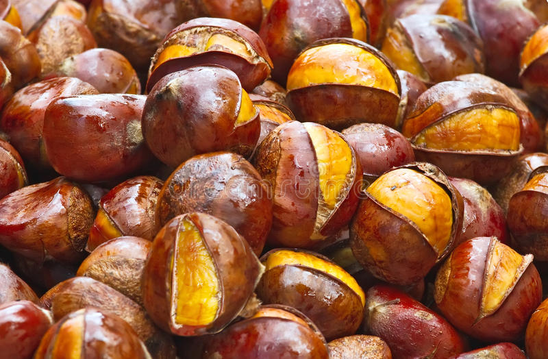 Popular Chinese snack stir fried chestnuts. Background photo of the popular Chinese snack stir fried chestnuts with sugar stock images