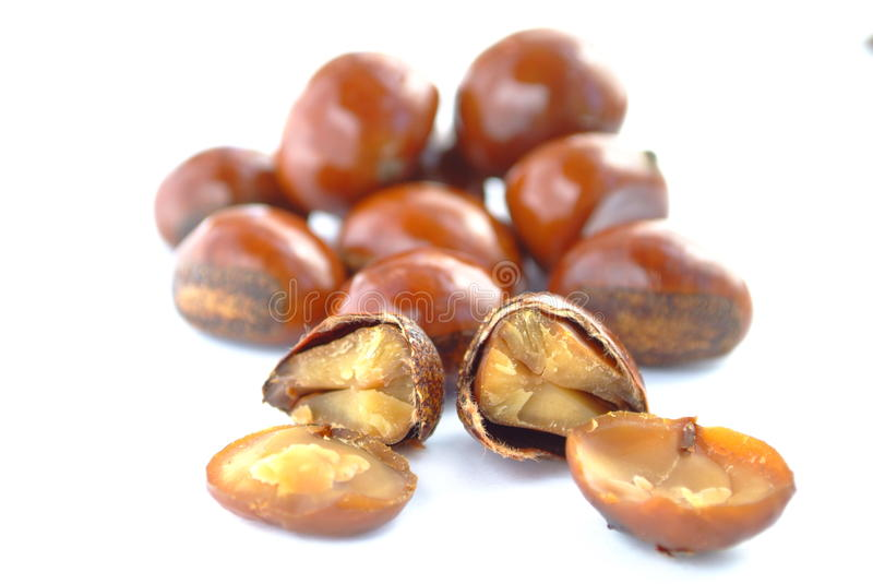 Popular Chinese snack stir fried chestnuts. Open chestnut on white background. Isolation of the Popular Chinese snack stir fried chestnuts with sugar royalty free stock images