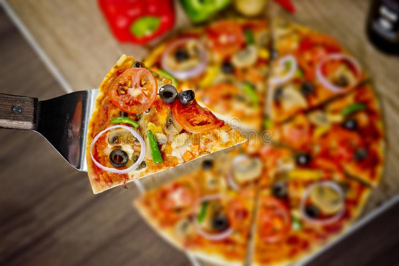 Popular colorful ingredients as like tomatoes, cheese, mushroom, capsicum, olives and other ingredients baked healthy Pizza.  stock photography