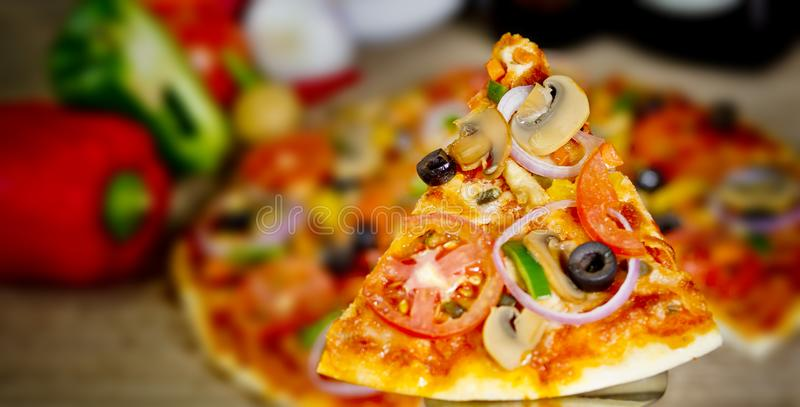 Popular colorful ingredients as like tomatoes, cheese, mushroom, capsicum, olives and other ingredients baked healthy Pizza.  stock image