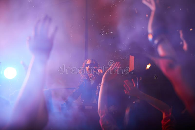 Popular dj playing at party royalty free stock photo