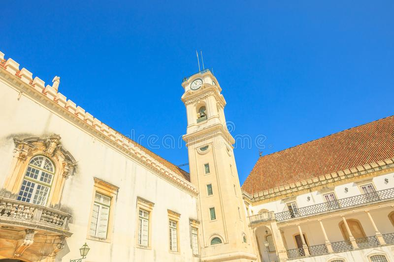 Coimbra Clock Tower. Popular and iconic University Clock Tower in blue sky. The University of Coimbra is the most ancient of Portugal and also one of the oldest royalty free stock images